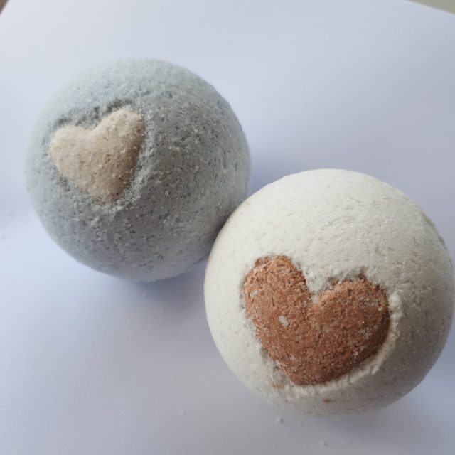 These bath bombs are a little different. Rather than using flowers or glitter to decorate them, we made some small hearts using the bath bomb recipe and used those (after allowing them to harden) It's a cute little tweak that can be helpful to give a bit more excitement to bath bombs you are making as gifts if you don't have other embellishments on hand. . . . . . . #diygifts #homemadegifts  #diygiftsarethebest #diygiftsandcrafts #homemadegiftsarethebest #homemadegiftsarebest #homemadegift #homemadegiftideas #diygift #sustainablegifts #chemicalfree #chemicalfreeliving #diyrecipes #toxfreeliving #chemicalfreebeauty #toxfreebeauty #toxfreepersonalcare #nochemicals #greenproducts #diyskinscare #greenbeautylover #organicbeauty #naturalbeautyproducts #sustainablebeauty #Lowtox #lowtoxliving #cleanliving #toxfree #naturalgifts #greengifts